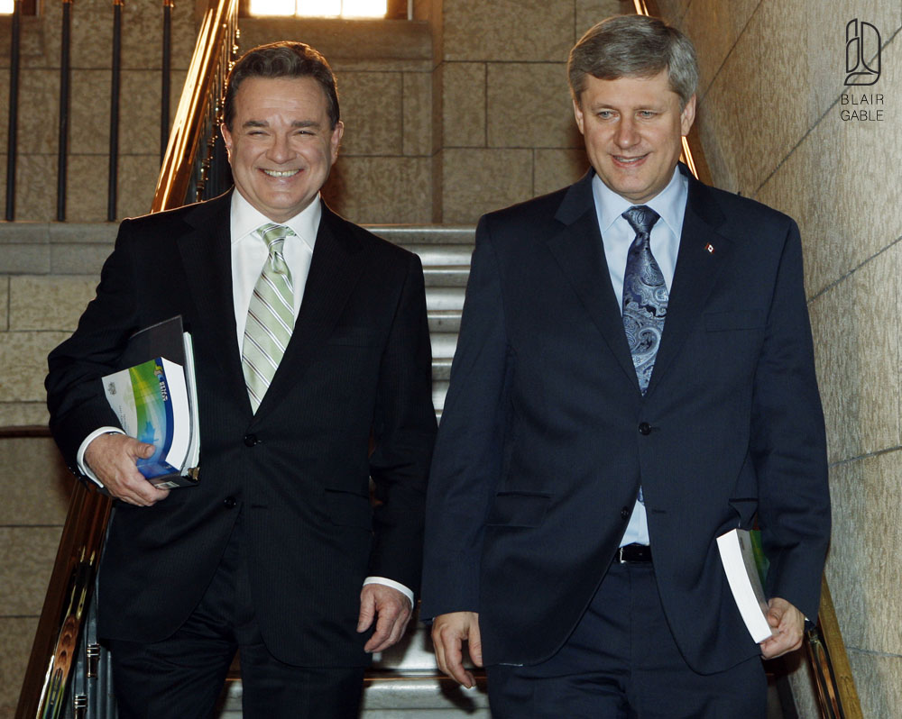 Canada's PM Harper and Finance Minister Flaherty walk to the House of Commons to deliver the budget on Parliament Hill in Ottawa