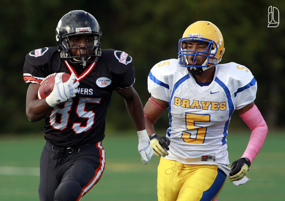 Ottawa Sooners Dechaun Beals evades by Burlington Braves Devon Miller