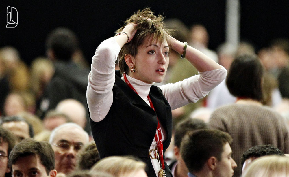 A Liberal convention delegate reacts to a programming delay