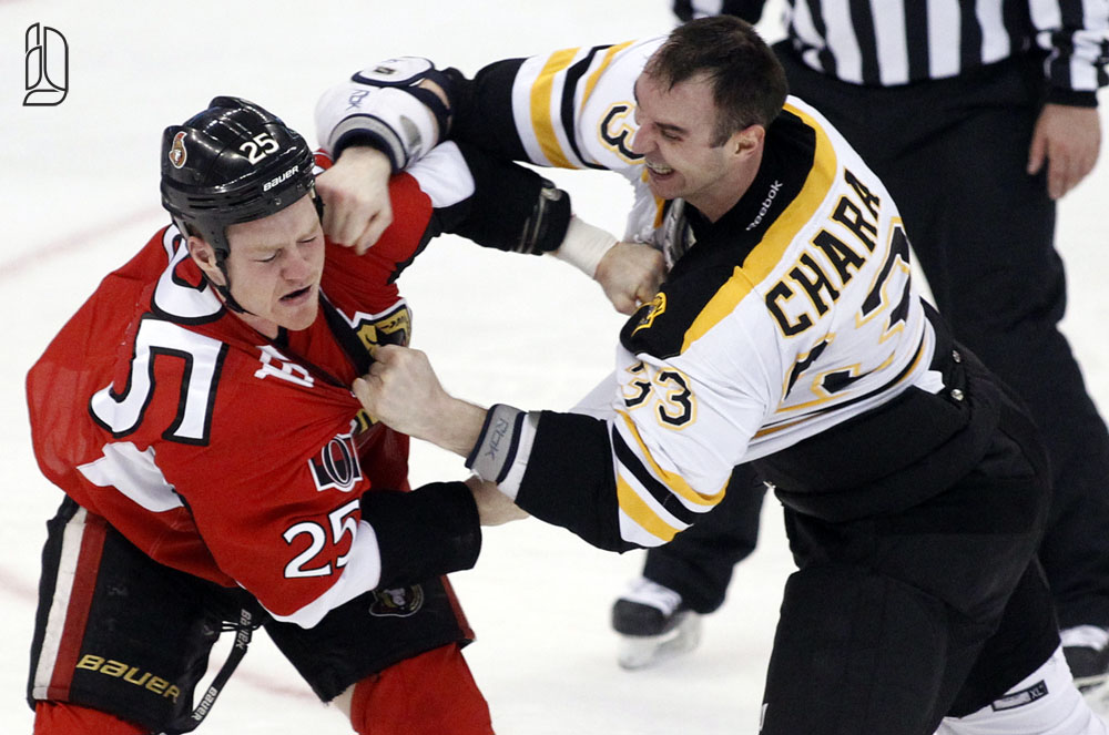 Ottawa Senators' Neil takes a punch from Boston Bruins' Chara