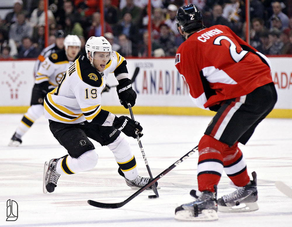 Boston Bruins' Seguin tries to move the puck around Ottawa Senators' Cowen