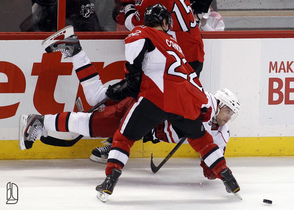 Carolina Hurricanes' Ruutu is hit by Ottawa Senators' Condra and Smith