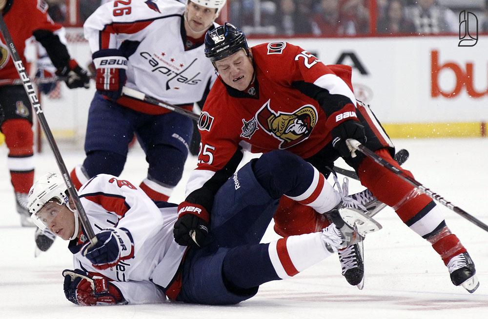 Washington Capitals' Semin is hit by Ottawa Senators' Neil
