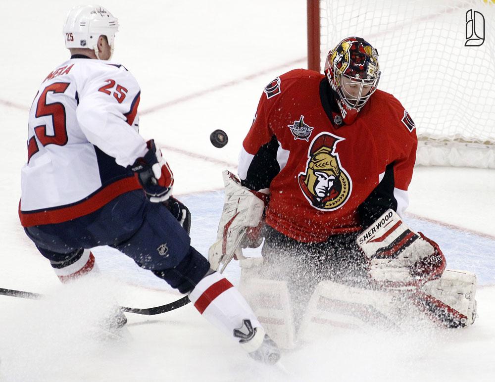 Ottawa Senators' Anderson stops a shot on net by Washington Capitals' Chimera