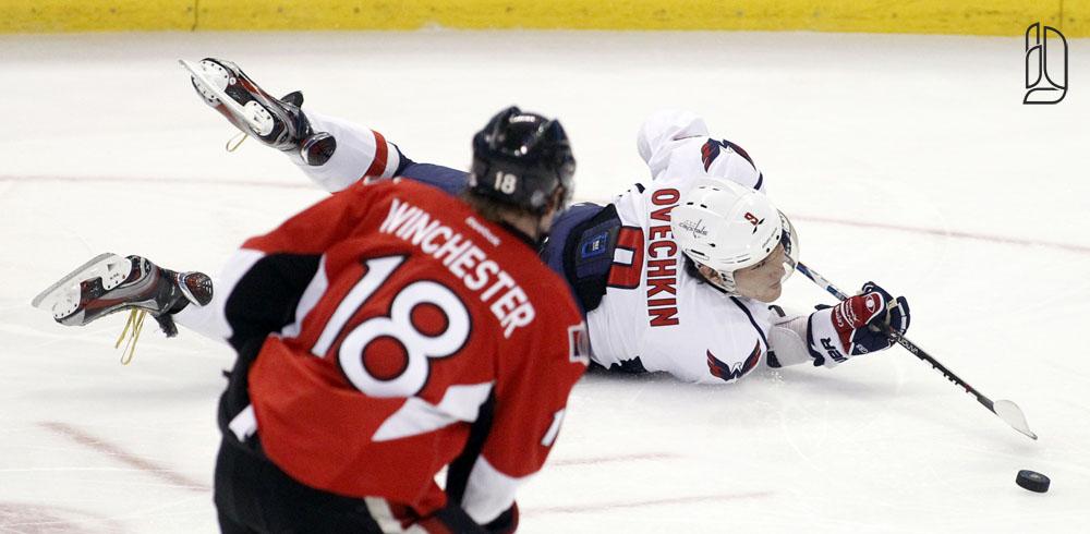 Washington Capitals' Ovechkin controls the puck in front of Ottawa Senators' Winchester