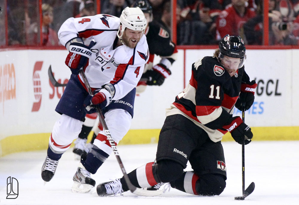 Ottawa Senators' Alfredsson keeps the puck from Washington Capitals' Erskine