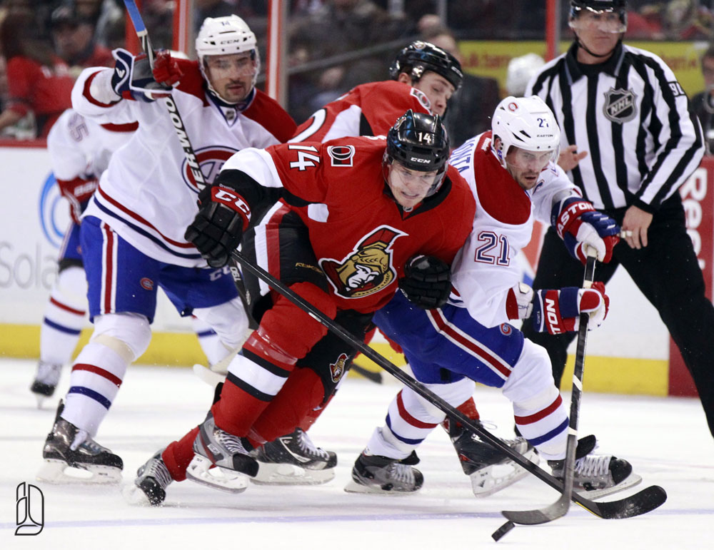 Ottawa Senators' Greening and Montreal Canadiens' Gionta struggle for control