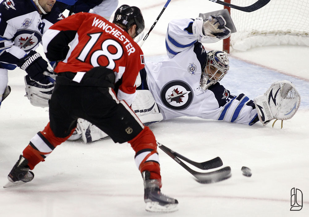 Ottawa Senators' Winchester is denied a scoring chance by Winnipeg Jets' Pavelec