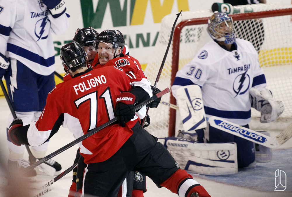 Senators' Foligno, Alfredsson and Winchester celebrate a goal against Lightning' Roloson