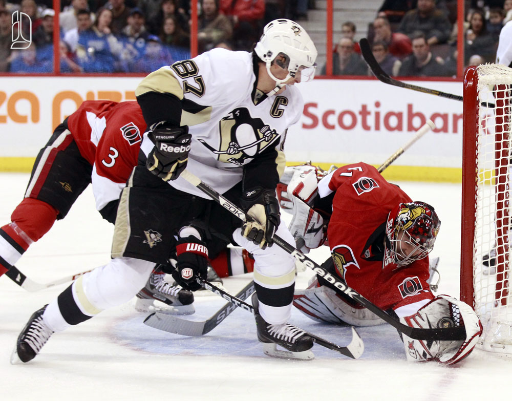 Ottawa Senators' Anderson stops a scoring attempt by Pittsburgh Penguins' Crosby