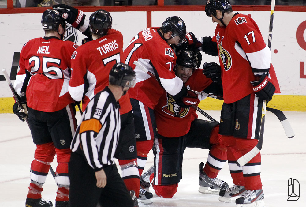 Ottawa Senators' Chris Phillips (C) celebrates his goal