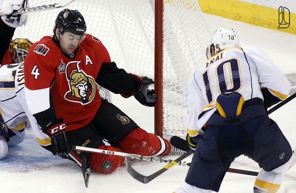 Ottawa Senators' Phillips attempts to block a shot