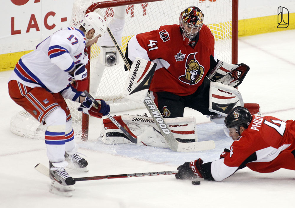 Senators' Phillips makes a diving block in front of Anderson as Rangers' Dubinsky takes a shot on net