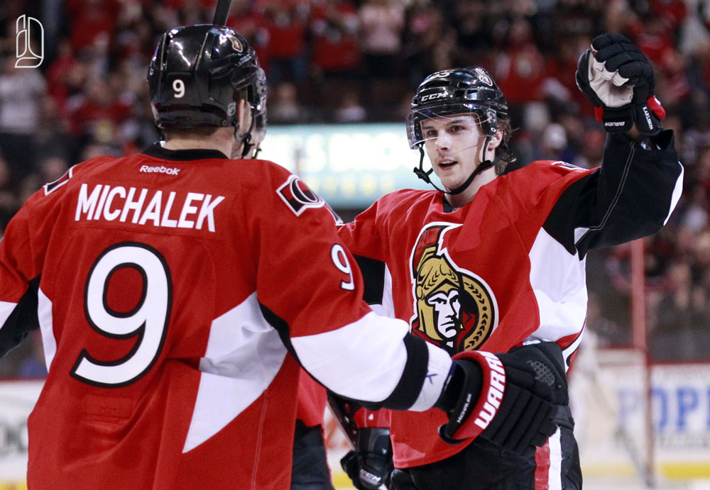 Ottawa Senators' Karlsson celebrates his goal with teammate Michalek